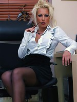 When Lana gets bored in the office she plays with her pussy